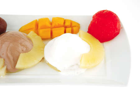 tropical fruits and ice cream on white plate Stock Photo - 7813545