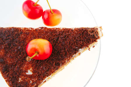 fresh cherry and cheese cake on transparent dish photo