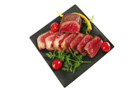roast beef on dark with fennel and tomatoes photo