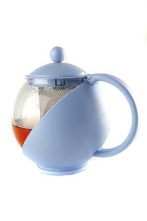 blue tea kettle with tea on white photo
