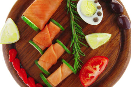smoked salmon on dark wood with hot peppers photo