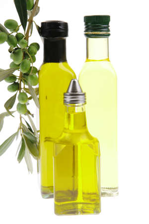 green raw olives on a branch with oil photo
