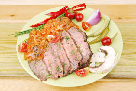 corned beef on plate over wooden table photo