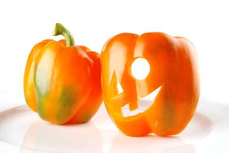 fresh orange bell pepper isolated over white background photo