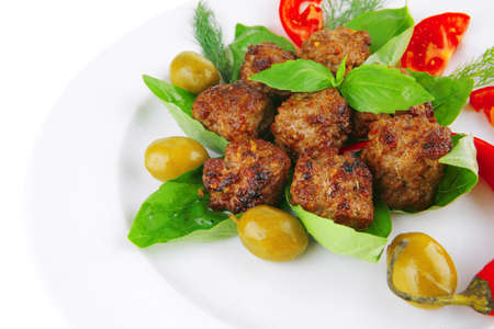 beef meatballs on basil with tomatoes and hot pepper photo
