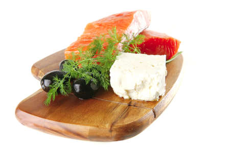 smoked pink salmon chunk with olives and white cheese photo