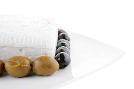 image of feta cheese cube on white plate photo