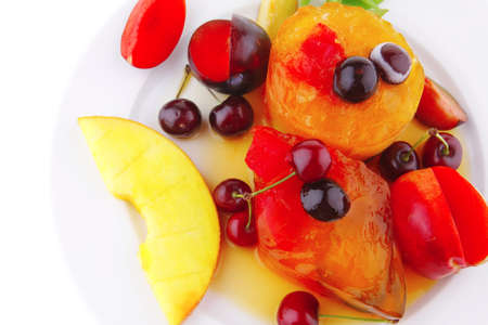 fruit ice cream with raw fruits on plate photo