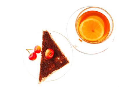 tea and cherry with cake on white photo