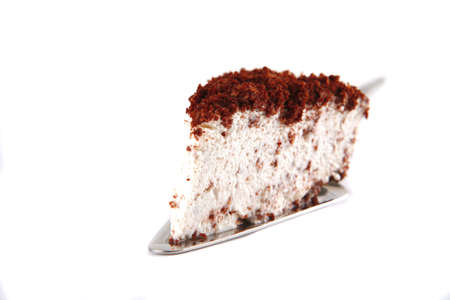 chocolate pie on small paddle over white photo