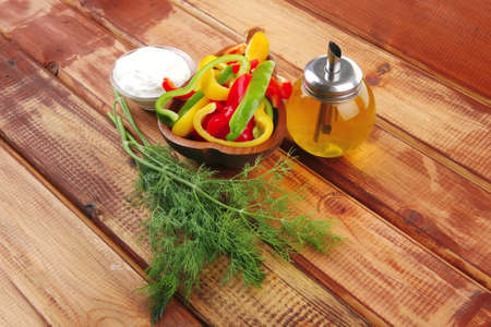 peppers sliced for salad on wooden table Stock Photo - 8051977