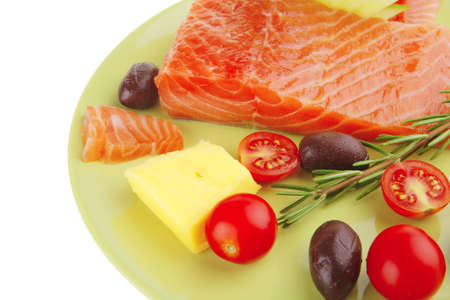 smoked salmon bar on plate with vegetables photo