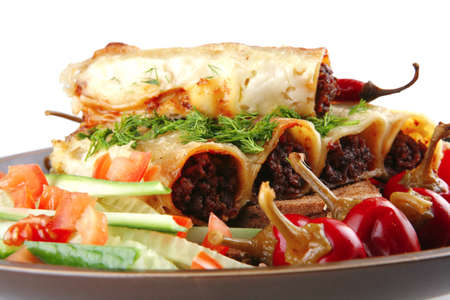 traditional italian cannelloni with fresh tomato cherry peppers photo