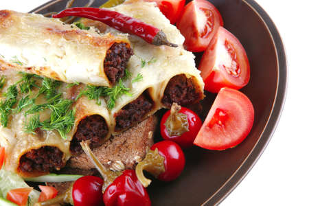 traditional italian cannelloni with tomato cherry and hot peppers photo
