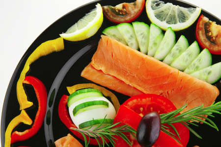 image of salmon served with vegetables on plate photo