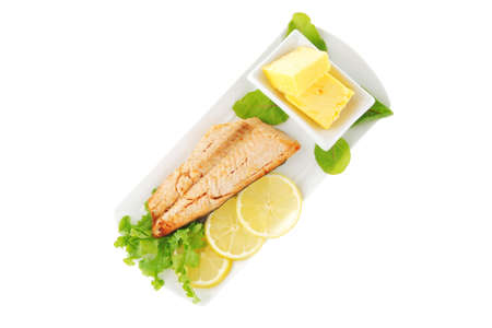 salmon steak and butter with green salad photo
