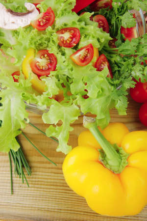 fresh salad and cherry's on wooden table Stock Photo - 8212515