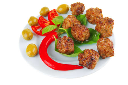 meatballs on blue dish with pepper and tomatoes photo