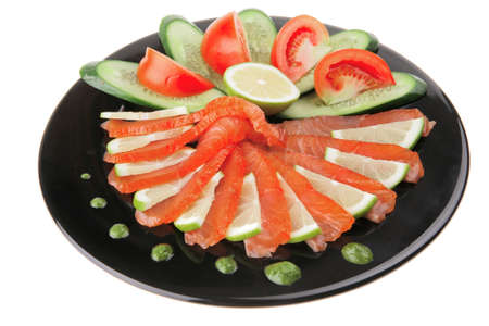 salmon slices and tomatoes on black plate photo