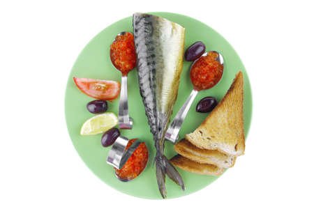 fish and caviar with toast on green dish photo