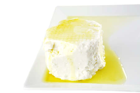 white soft cheese with olive oil on white dish Stock Photo - 8279250