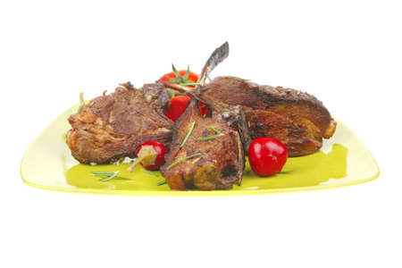 meat savory: roast ribs on green plate with peppers and chives photo