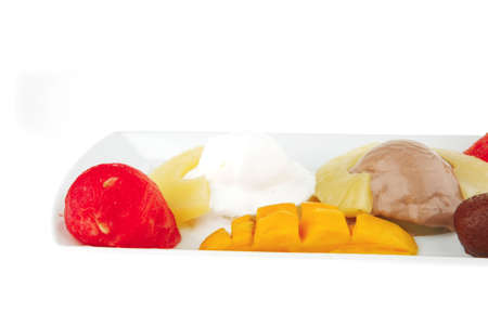 ice cream on pineapple with mango on plate Stock Photo - 8371346