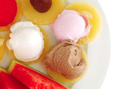 plate full of fruits and ice cream on white photo