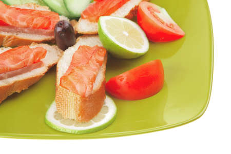 small salmon sandwich on green plate over white photo