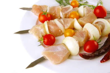 raw chicken shish kebab on white plate Stock Photo - 8477868