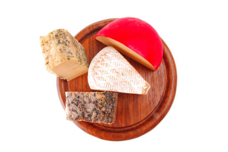 different cheeses on wood over white background photo