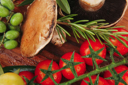 fresh vegetables on wood over white background