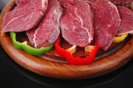 fresh meat on wood with sliced pepper photo