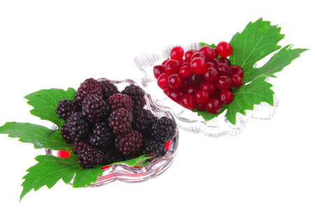 served berrys in transparent glass over white photo