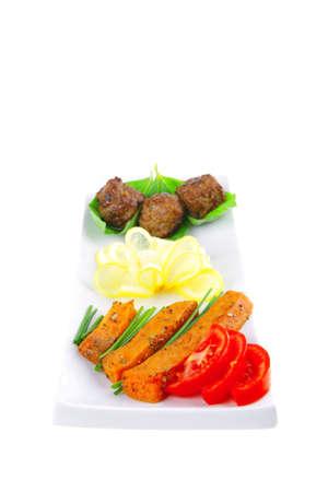 roast meatballs on basil over white plate photo