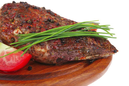savory plate on wood : grilled shoulder on plate with chives and tomato isolated on white background photo
