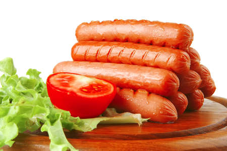 veal sausage: beef grilled sausages served on plate with vegetables