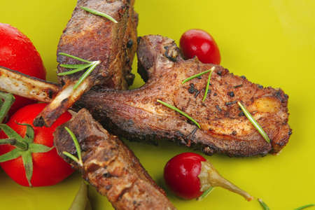 entree: served entree: ribs on plate with hot peppers and capers on green