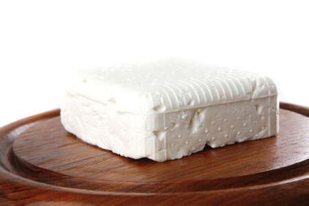 whole light soft feta cheese on dishware photo