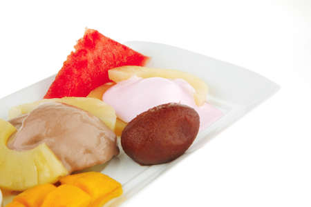 ice cream on pineapple with mango on plate Stock Photo