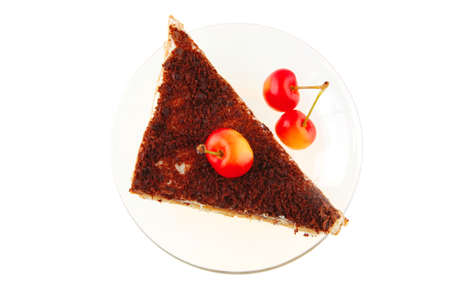 cheesecake with cherry on transparent saucer on white photo