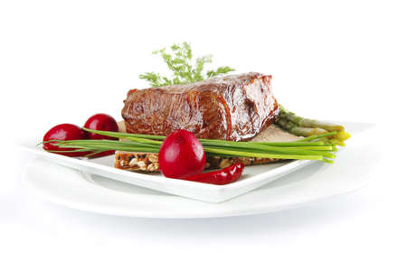 white plate: meat with spices and eggplant on white plate Stock Photo