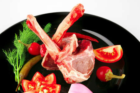 raw lamb chops on plate with vegetables Stock Photo - 8754274