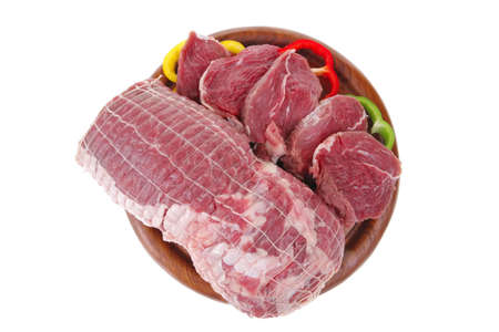fresh uncooked meat chunk on  wooden board  photo