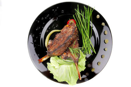 cooked pepper ball: meat savory: roast ribs on black plate with peppers and chives Stock Photo