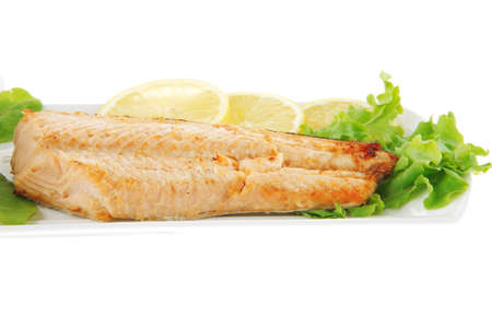 big grilled salmon steak over white plate photo