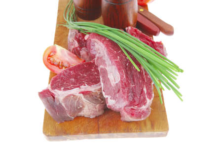 pepper castor: savory : bloody beef raw steak on wood cut board ready to cooking Stock Photo