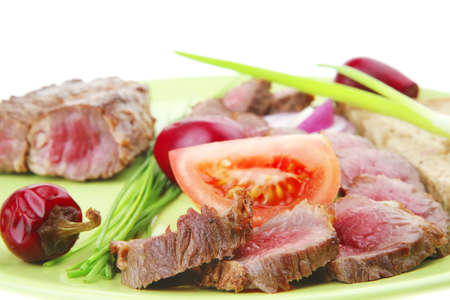 meat food : bbq meat served on green plate with tomatoes and sprouts isolated on white background . shallow dof Stock Photo - 8954599