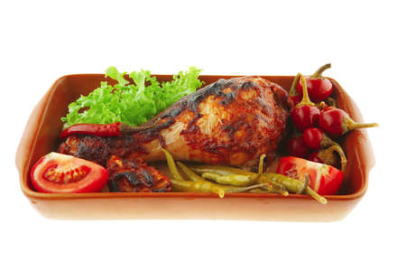 roasted chicken legs and peppers with lettuce photo