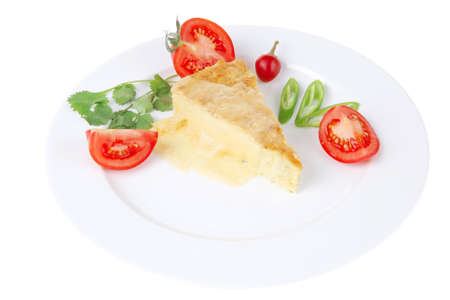 food : cheese casserole piece over white plate served with peppers and tomatoes isolated over white background photo
